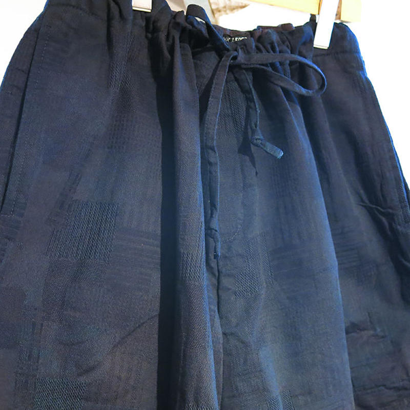 INDIGO DYED WASHED COTTON TROUSERS