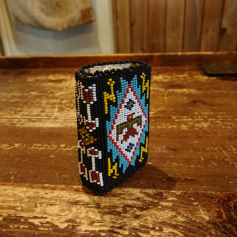 Cigarette case made with beads.
