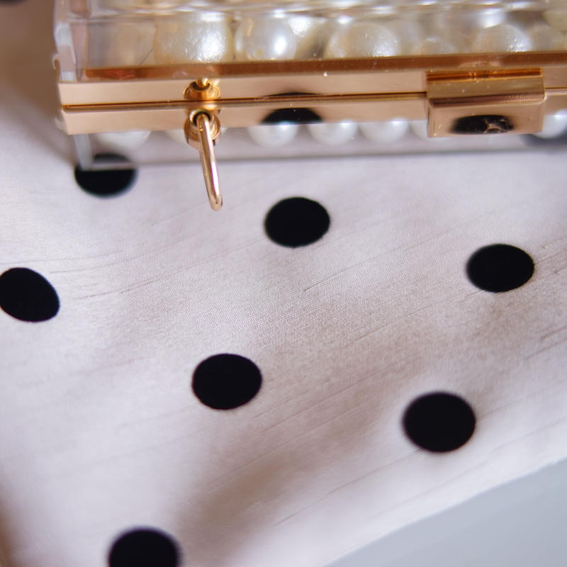 black dots beige fabric