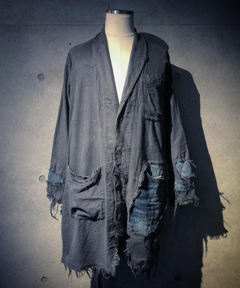 Different fabrics sewn navy coat