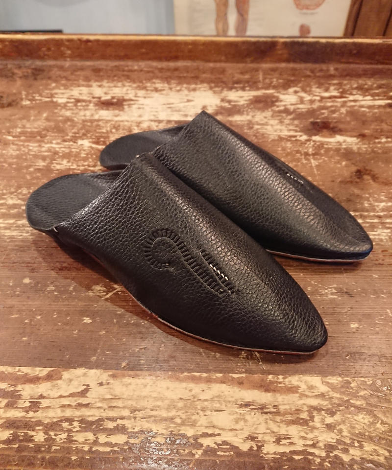 Old  black leather slippers.