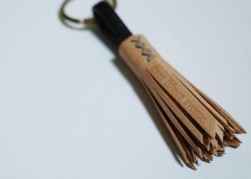 three fifteen tassel key holder