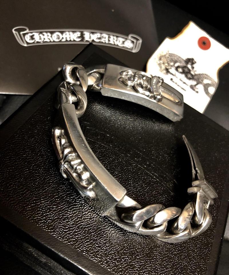DiamondJewelryNY Double Loop Bangle Bracelet with a St John Neumann Charm.